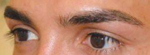 regard intense sourcils hommes